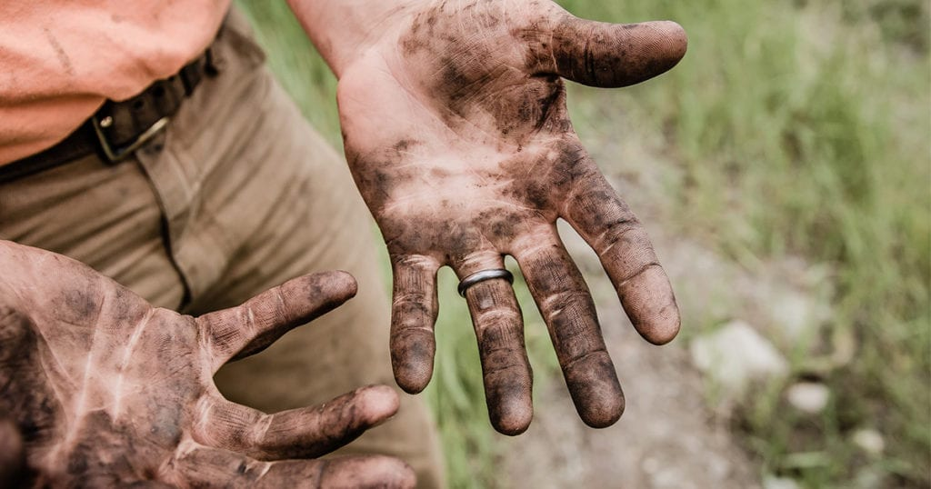 Man with dirty hands